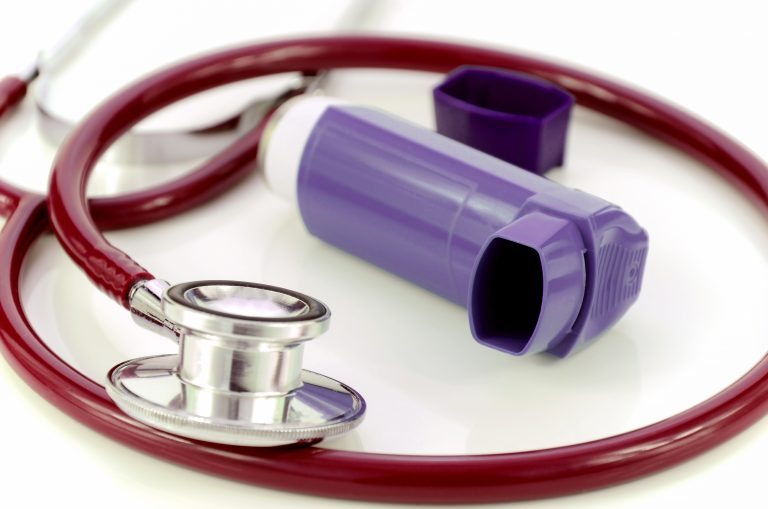 asthma inhaler and stethoscope