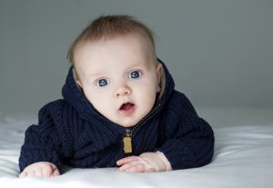 cute baby boy in blue sweather