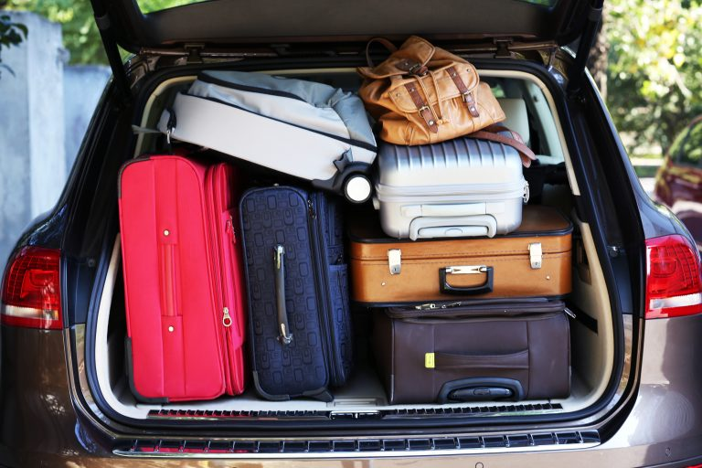 suitcases and bags in the trunk of the car