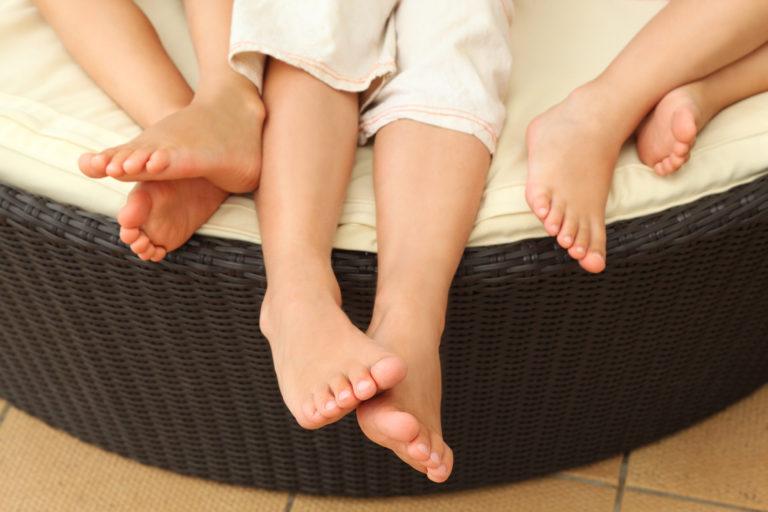 legs of three kids