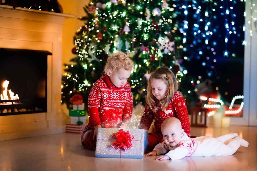 kids with presents under the xmas tree